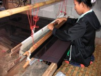 woman weaving silk in korat province