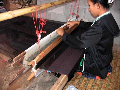 woman weaving silk in korat province